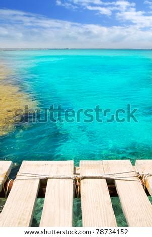 Illetes illetas beach wooden pier turquoise sea Formentera Balearic islands Mediterranean - stock photo