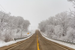 Illinois Rt 178 surrounded by snow and ice on a cold and foggy winters day.