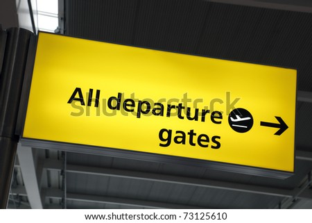 Illuminated airport departure gates direction sign