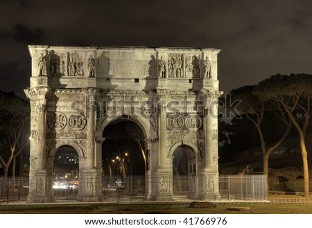 Illuminated Arch of Constantine at night, Rome, Italy - stock photo