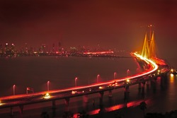 Illuminated Bandra-Worli Sealink, officially called Rajiv Gandhi Sea Link at night. It is a cable-stayed vehicular bridge that links Bandra in the northern suburb of Mumbai with Worli in South Mumbai