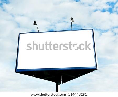 Illuminated big blank billboard over cloudy blue sky