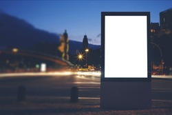 Illuminated blank billboard with copy space for your text message or content, public information board in night city with beautiful dusk on background, advertising mock up banner in metropolitan city