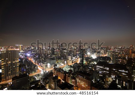 Illuminated buildings and road during sunset in Tokyo, Japan