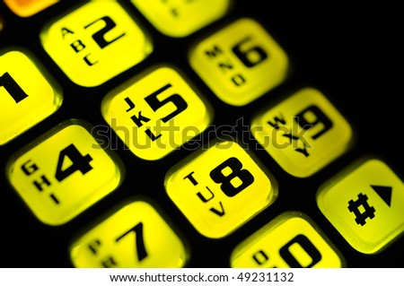 Illuminated cell phone keyboard - stock photo