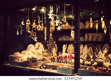 Illuminated Christmas fair kiosk with loads of lovely handcrafted wooden xmas decorations