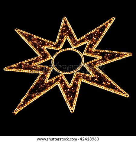 Illuminated Christmas Star Decoration on Black at a Christmas Market (Weihnachtsmarkt) in Germany - stock photo