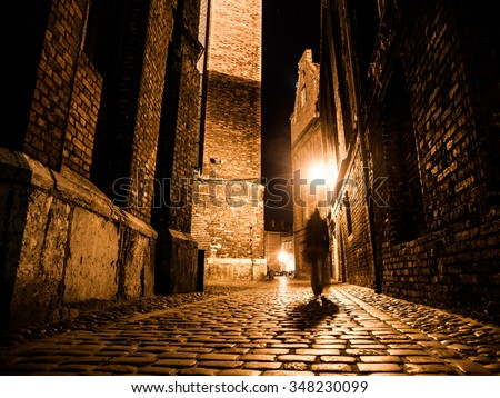 stock photo illuminated cobbled street with light reflections on cobblestones in old historical city by night 348230099 - Каталог — Фотообои «Улицы, переулки»