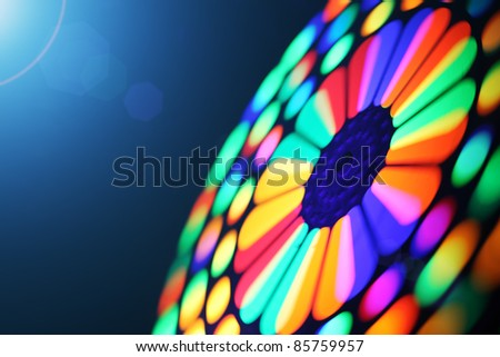 Illuminated colorful spectrum spinning wheel, motion blur background.