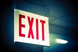 Illuminated Corporate Office Exit Sign Closeup.