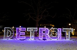 Illuminated DETROIT neon sign in downtown Detroit, Michigan, USA during winter.