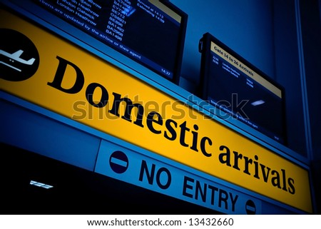 Illuminated domestic arrival sign in an airport