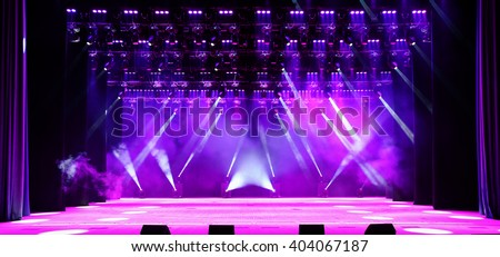 Illuminated empty concert stage with purple light and stage fog