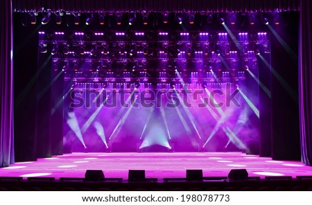 Illuminated empty magenta concert stage with fog and rays of light #198078773
