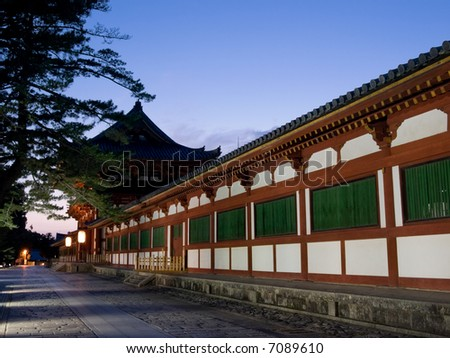 Illuminated evening view of the gate and wall surrounding Todaiji temple in Nara, Japan. Todai-ji is reputedly the largest wooden building in the world.