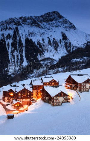 Illuminated french mountain village in the evening