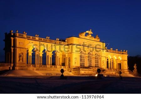 Illuminated Glorietta at Schonbrunn Park at winter night in Vienna, Austria.