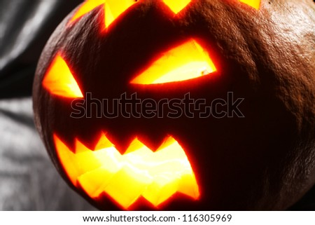 Illuminated halloween pumpkin on a black background