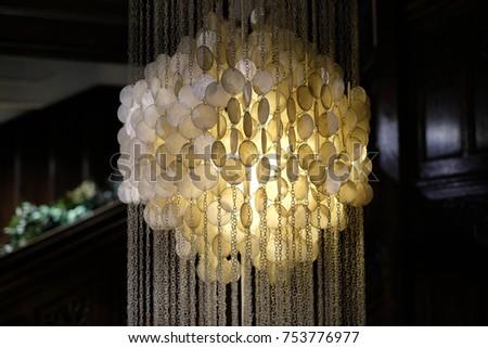 Illuminated hanging chandelier light fitting, photographed November 2017 #753776977