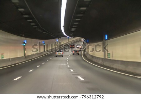illuminated highway tunnel and road