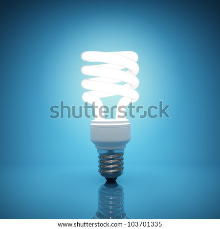 Illuminated light bulb on blue background