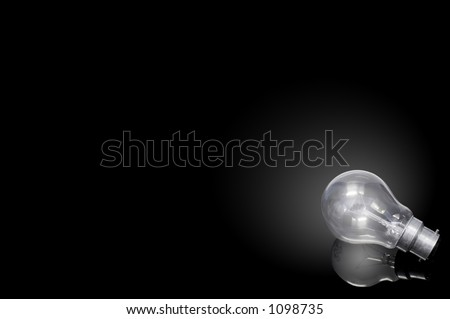 illuminated lightbulb on black background