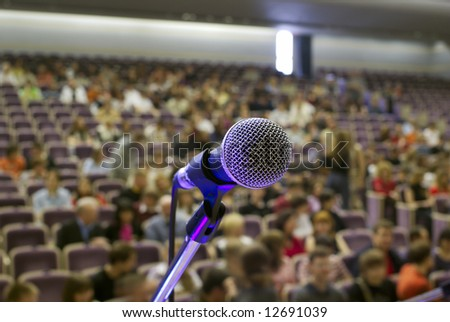 illuminated microphone on the stage and auditorium