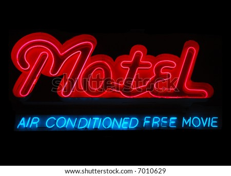 Illuminated motel neon sign with air conditioning and free movie