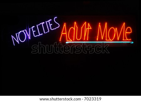 stock photo : Illuminated novelties and adult movie neon sign