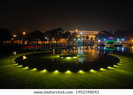 Illuminated, Parliament house, India is the seat of the Parliament of India. At a distance of 750 meters from Rashtrapati Bhavan, it is located along Sansad Marg which crosses the Central Vista.  Photo stock ©