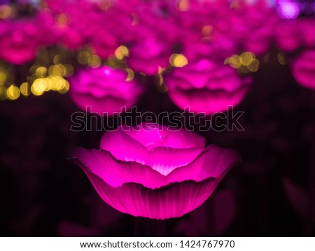 Illuminated pink LED artificial flowers. Selective focus and background.. Selective focus and background. #1424767970