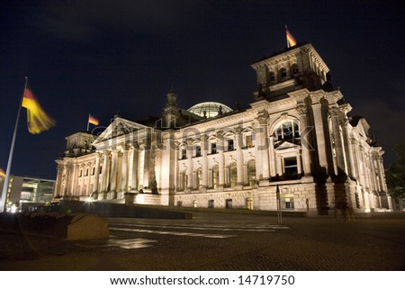 Illuminated Reichstag Building in Berlin, night-time view from the South-Western corner