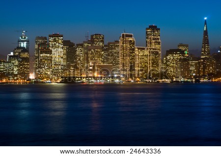 Illuminated San Francisco downtown at dusk (shot from Treasure Island). This illumination is on only for Christmas and New Year (~1.5 months per year). Copyspace on top and bottom