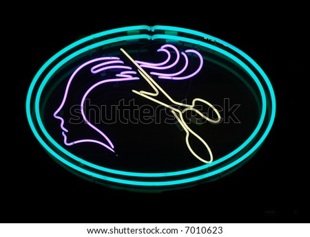 Illuminated scissors cutting long hair neon sign