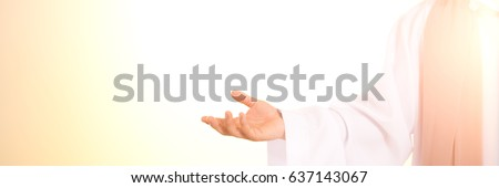 Illuminated silhouette of Jesus Christ in white robe #637143067