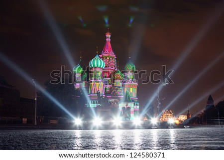 Illuminated St. Basil Cathedral and spotlight at night in Red Square in Moscow, Russia.