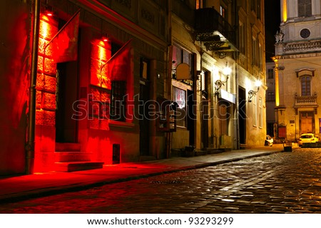 illuminated street at night. Old european city