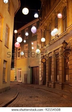 illuminated street in old part of Riga by night