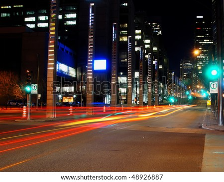Illuminated Street of Montreal with light trail car at Night