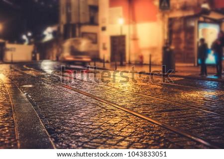 Illuminated street of old european town at night. Tilt-shift effect #1043833051