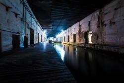 Illuminated submarine base of Saint-Nazaire at night, France. Travel destinations, sightseeing, history, World War II theme