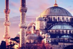 Illuminated Sultan Ahmed Mosque (Blue Mosque) before sunrise, Istanbul, Turkey