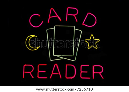 Illuminated tarot card reader neon sign on black - stock photo