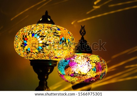 Illuminated Turkish Moroccan handmade stain glass lamps. Vibrant and colourful with unique light flare flashes, trails, streaks running through. Antique bronze. Traditional Background concept. #1566975301
