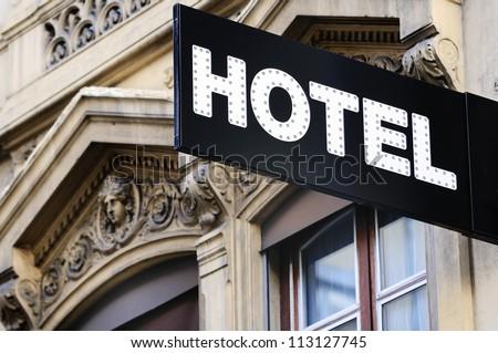 Illuminated urban hotel sign