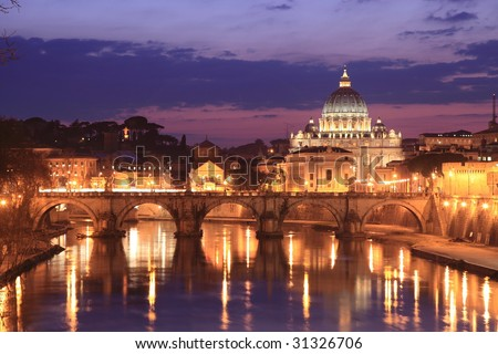 Illuminated Vatican viewed from Rome, with reflections in the water