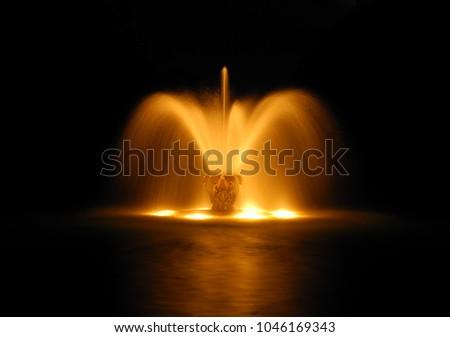 Illuminated water fountain at night. The Herrenhausen Gardens of Herrenhausen Palace an urban district of Lower Saxony's capital of Hanover. The gardens are a heritage of the Kings of Hanover. #1046169343