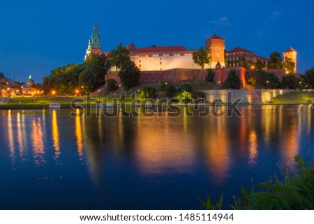Illuminated Wawel Royal Castle in the evening. Beautiful reflection in the Wisla river. Krakow, Lesser Poland, Poland. #1485114944