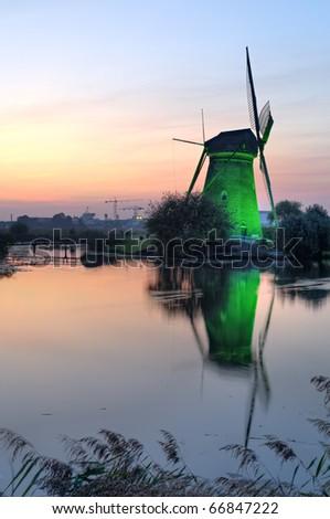 Illuminated windmill at dusk Kinderdijk, The Netherlands