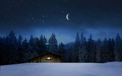 Illuminated wooden hut in a winter night